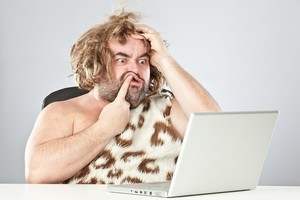 prehistoric man on laptop